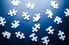 Puzzles on a dark white background. Business background Royalty Free Stock Photos