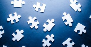 Puzzles on a dark white background. Business background Royalty Free Stock Photo