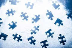Puzzles on a dark white background. Business background Stock Image