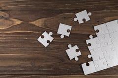 Puzzles de papier sur un plancher Photo libre de droits