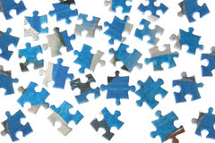 Puzzles dispersed on a white background. Stock Images