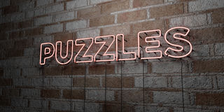 PUZZLES - Glowing Neon Sign on stonework wall - 3D rendered royalty free stock illustration Royalty Free Stock Photography