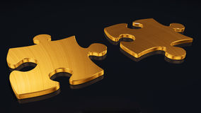 Puzzles from a gold. It is isolated on a black background Stock Photos