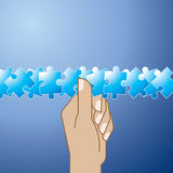 Puzzles in hand. Solution  to many pieces jigsaw puzzle business problem Royalty Free Stock Images