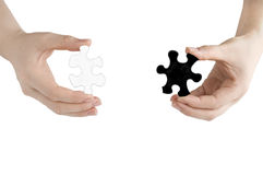 Puzzles in the hands Royalty Free Stock Photography