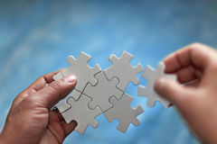 Puzzles and hands Royalty Free Stock Photo