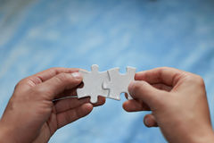 Puzzles and hands Royalty Free Stock Photos