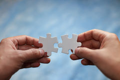 Puzzles and hands Royalty Free Stock Images