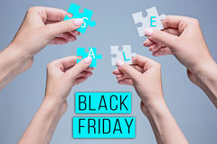 The puzzles in hands on gray. Background. Black Friday sale - holiday shopping concept Stock Photography