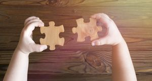 Puzzles in hands. logics. Stock Photography