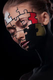 Puzzles painted on face. Puzzles painted on a beautiful woman's face Royalty Free Stock Photo