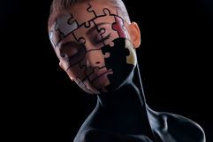 Puzzles painted on face Royalty Free Stock Image