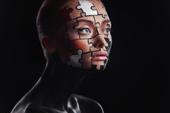 Puzzles painted on face. Puzzles painted on a beautiful woman's face Stock Photo