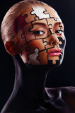 Puzzles painted on face. Puzzles painted on a beautiful woman's face Stock Images