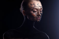 Puzzles painted on face. Puzzles painted on a beautiful woman's face Royalty Free Stock Photography