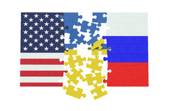 Puzzles of Ukraine, Russia and USA flags Royalty Free Stock Photo
