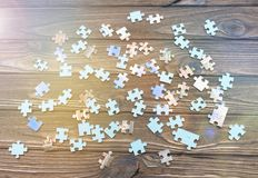 Puzzles on a wooden background.developing manual for children. Puzzles on a wooden background. logical game. preschool education. pieces of the puzzle Royalty Free Stock Photo