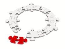 Puzzlespiel auf weißem Hintergrund Lizenzfreie Stockfotos