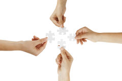 Puzzlespiel in den Händen Lizenzfreie Stockbilder