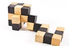 Puzzlespiel in der Form der hölzernen Blöcke Stockfoto