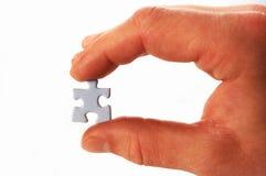 Puzzlespiel in der Hand Stockfotos