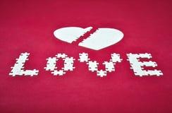 Puzzlespiel des unterbrochenen Inneren der Liebe Stockfoto