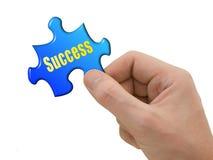 Puzzlespiel-Erfolg in der Hand Stockfotografie