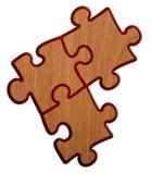 Puzzlespiel - hölzerne Version auf weißem Hintergrund 2 Lizenzfreie Stockfotos