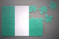 Puzzlespiel mit der Staatsflagge von Nigeria Lizenzfreies Stockfoto