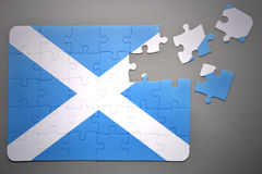 Puzzlespiel mit der Staatsflagge von Schottland Lizenzfreie Stockfotos