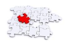 Puzzlespiel mit einem wichtigen Stück Lizenzfreie Stockbilder
