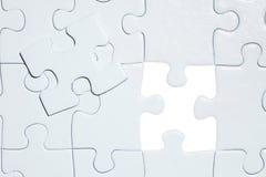 Puzzlespiel mit fehlendem Stück Stockbilder