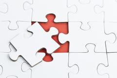 Puzzlespiel mit fehlendem Teil Stockfotos
