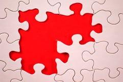 Puzzlespiel mit orange Hintergrund stockfotos