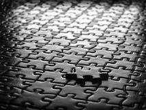 Puzzlespiel-Stücke abgeschlossen Stockfoto