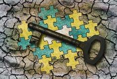 Puzzlespiel und ein Schlüssel Stockfotos