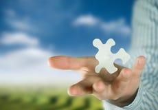 Puzzlespiel und Lösung Lizenzfreie Stockfotos