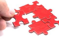 Puzzlespiel und Laubsäge Stockfoto