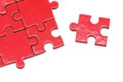 Puzzlespiel und Laubsäge Stockbilder