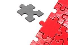 Puzzlespiel und Laubsäge Stockfotografie