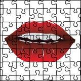 Puzzlespiel und rote Lippen Lizenzfreies Stockfoto
