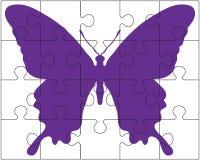 Puzzlespiel und Schmetterling Stockfotografie