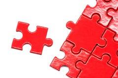 Puzzlespiel und Spannvorrichtungen lokalisierten Hintergrund Stockbilder