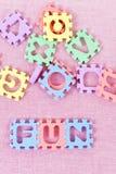 Puzzlespiel-Zeichen-Spaß Stockbild