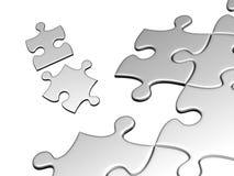 Puzzlespiele festgeklemmt auf weißem Hintergrund Lizenzfreies Stockbild