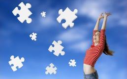 Puzzlespielfrau Stockfotos