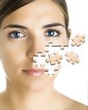 Puzzlespielgesicht Lizenzfreie Stockfotografie