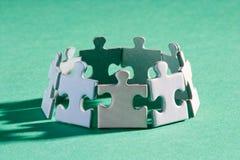 Puzzlespielgruppenschatten Stockfoto