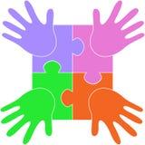 Puzzlespielhände Stockbild