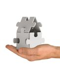 Puzzlespielhaus an Hand Stockfotos